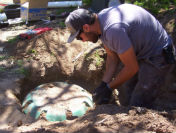 Robby opening septic tank